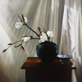 White magnolias in green vase