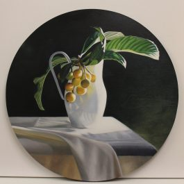 Loquats in white jug