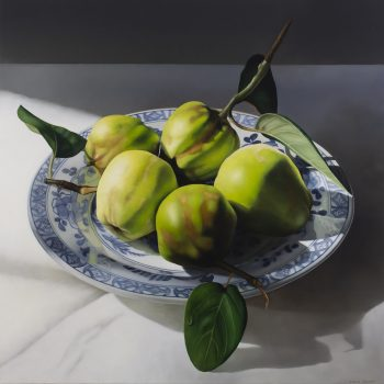 Still life with quinces on blue plate